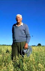 Grandfather Austie L'Estrange in an oat crop on land he cleared with an axe as a young man near Condobolin, NSW. Photo by Merrill Findlay, 1987.