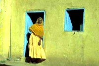 The other side of the war: a mother who fled with her children to a refugee camp in Sudan. Photo by Merrill Findlay, Kassala, Sudan, 1988.