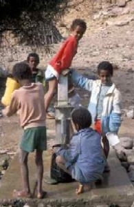 Children at a tube well during a break from school in one of Eritrea's displaced persons' camps. Photo by Merrill Findlay, 1988,