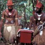 Young warriors from Eddie Mabo's Piadram clan carry his casket through the bamboo forest on Mer. Photo by Merrill Findlay, 1995.