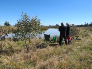 Arts OutWest's Tracey Callinan (in red) and Mark Findlay picnic during the videoing. Photo by Maryanne Jacque, 6 August 2014.