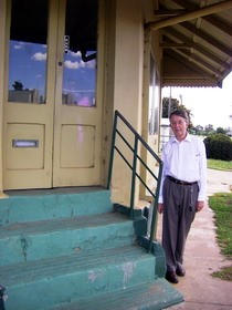 "Archaeologist Dr Ian Jack, President of the Royal Australian Historical Society, inspecting 161 Rankin Street in October 2008. This photo also shows the raised floor level, one of Quong Lee's vernacular design innovations to 'flood proof' the building. The RAHS annual conference in Forbes unanimously carried a resolution recognising the ""high historical significance"" of Quong Lee's Store as ""the principal item of Chinese heritage in the district'.  Photo courtesy RAHS, 2008."
