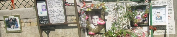 Images of some of the victims of past atrocities in Quetta at n Hazara cemetery. Photo by Merrill Findlay.