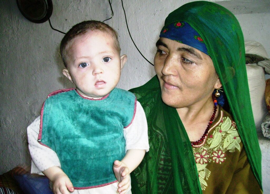 Turcoman mother and her malnourished child at the Khurasan Refugee Camp. Photo by Merrill Findlay, 2006.
